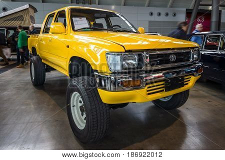 STUTTGART GERMANY - MARCH 03 2017: Compact pickup truck Toyota Hilux 1992. Europe's greatest classic car exhibition