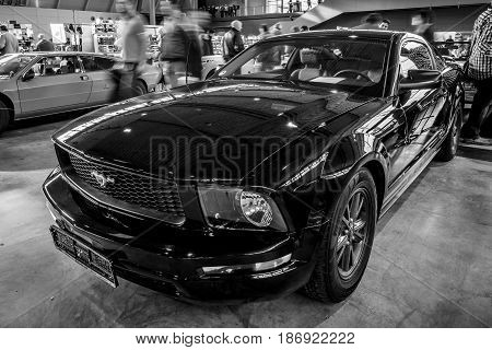 STUTTGART GERMANY - MARCH 03 2017: Pony car Ford Mustang V6 Coupe 2006. Black and white. Europe's greatest classic car exhibition