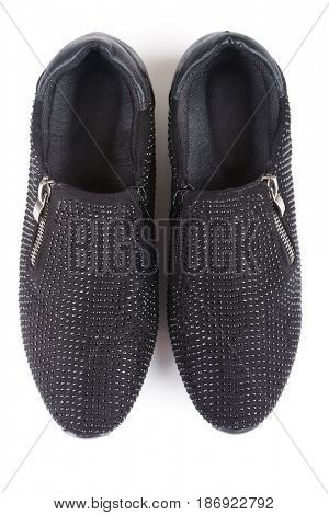 Black shoes with rhinestones isolated on white, top view
