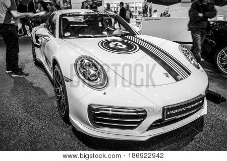 STUTTGART GERMANY - MARCH 03 2017: Sports car Porsche 911 Turbo S 2016. Black and white. Europe's greatest classic car exhibition