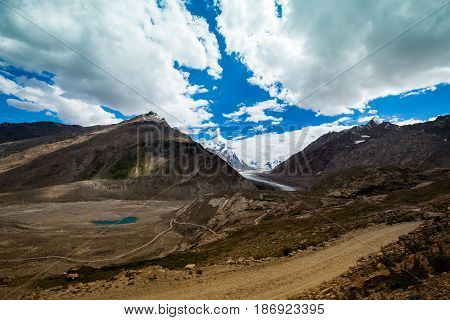 Beautiful nature on Dran Drung Glacier clouds covering the mountain peaks Zanskar, Himalayas India.