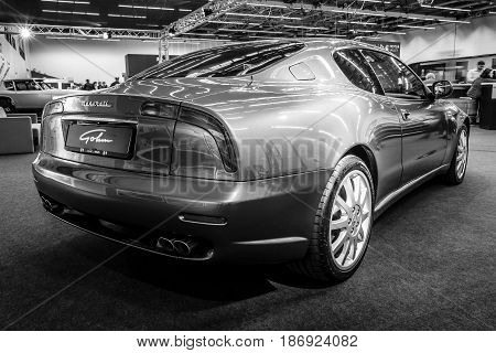 STUTTGART GERMANY - MARCH 03 2017: Grand Tourer car Maserati Coupe (Tipo M138) 2005. Rear view. Black and white. Europe's greatest classic car exhibition