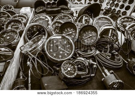 STUTTGART GERMANY - MARCH 03 2017: The point of sale of speedometers tachometers and odometers for vintage cars. Sepia toning. Europe's greatest classic car exhibition