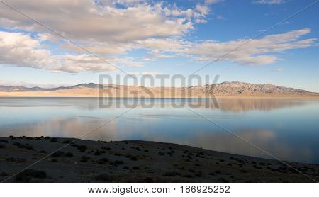Walker Lake reflects Chukar Ridge and Mount Ferguson view from 20 mile beach western USA