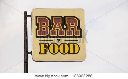 A generic roadside advertisement for a restaurant bar