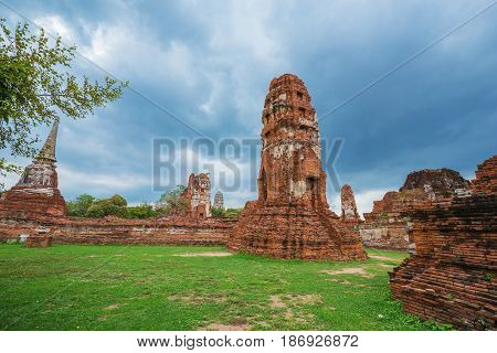 Ruins Of Buddha Statues And Pagoda Of Wat Mahathat In Ayutthaya Historical Park, Thailand