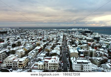 View of Old Town and seashore from the observation deck of Hallgrimskirkja church in central Reykjavik, Iceland.
