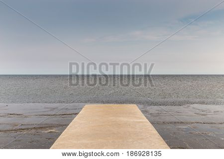 Seascape of cement bridge on the way to fisherman's harbor in Thailand.