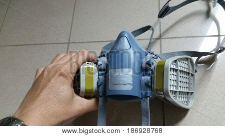 Multi-purpose respirator half mask for toxic gas protection. Officer prepare to use Multi-purpose respirator half mask.