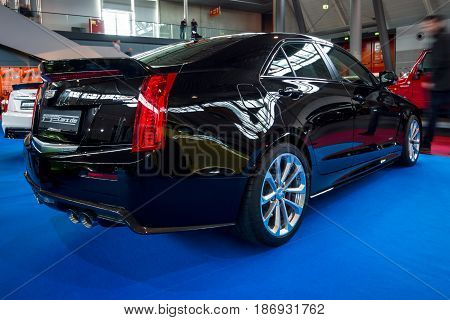 STUTTGART GERMANY - MARCH 03 2017: Entry-level luxury car Cadillac ATS-V 2016. Rear view. Europe's greatest classic car exhibition