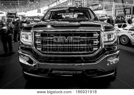STUTTGART GERMANY - MARCH 03 2017: Heavy-Duty pickup truck GMC Sierra 1500 Crew Cab SLT 2017. Black and white. Europe's greatest classic car exhibition