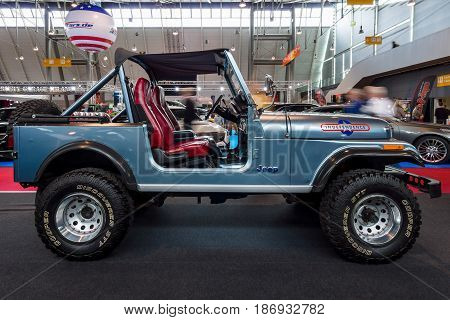 STUTTGART GERMANY - MARCH 03 2017: Compact sport utility vehicle Jeep CJ7 1980. Europe's greatest classic car exhibition