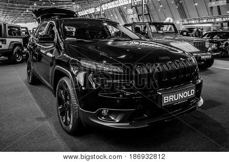 STUTTGART GERMANY - MARCH 03 2017: Mid-size luxury SUV Jeep Grand Cherokee 2017. Black and white. Europe's greatest classic car exhibition