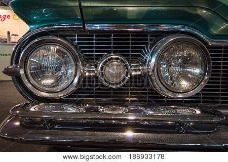 STUTTGART GERMANY - MARCH 03 2017: Headlamp of a full-size car Oldsmobile Super 88 1959. Close-up. Europe's greatest classic car exhibition