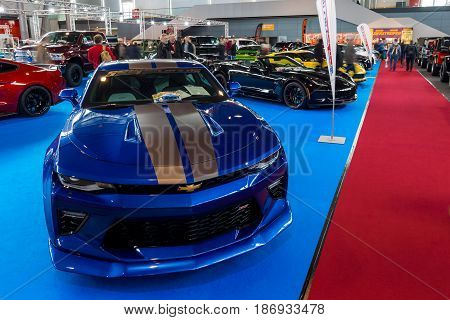 STUTTGART GERMANY - MARCH 03 2017: Stand with modern American cars. In the foreground Chevrolet Camaro SS (sixth generation). Europe's greatest classic car exhibition