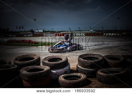 man drive go kart on track entering the curve