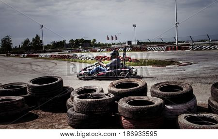 man drive go kart on track  outdoor shot