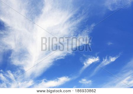 photo of blue sky with striking white clouds