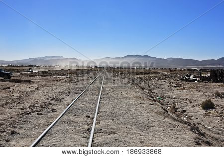 Bolivia old railway in the dry arid desert