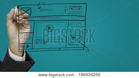 Digital composite of Hand with marker and website mock up against blue background