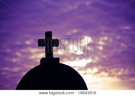 Silhouette of a church in the sunset time on a sunny cloudy summer evening