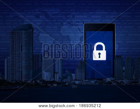 Key icon on modern smart phone screen with office city tower river digital world map and binary code Business internet security Elements of this image furnished by NASA