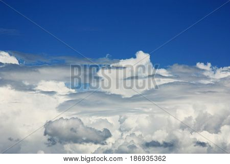 dark stormy clouds with blue sky on the top
