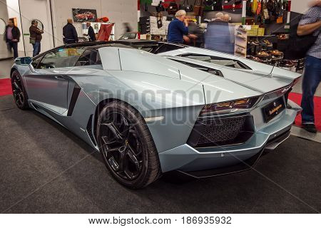 STUTTGART GERMANY - MARCH 03 2017: Sports car Lamborghini Aventador LP 700-4 2014. Rear view. Europe's greatest classic car exhibition