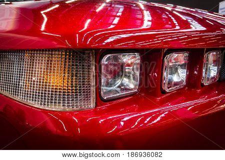 STUTTGART GERMANY - MARCH 03 2017: Headlamp of sports car Alfa Romeo SZ (Sprint Zagato) 1991. Close-up. Europe's greatest classic car exhibition