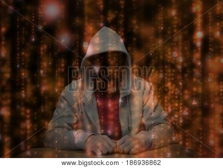 Digital composite of Red t shirt hacker with out face in the desk red code