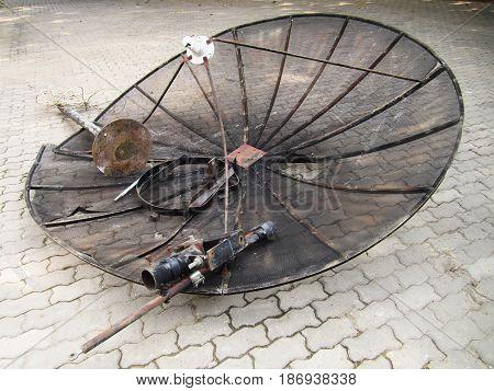 photo of broken satellite dish on the floor