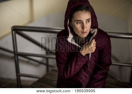 Cold Hopeless Woman Sitting Thoughtful
