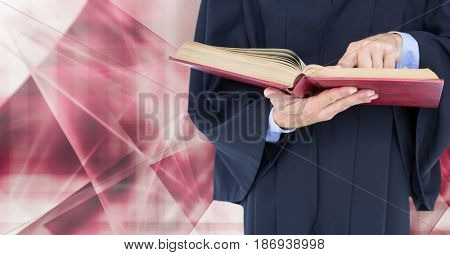 Digital composite of Judge holding book in front of abstract shapes