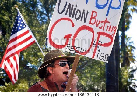 SACRAMENTO, CALIFORNIA, USA - February 26, 2011: Labor union supporter shouts slogans through megaphone at