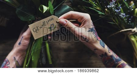 Florist Making Fresh Flowers Bouquet Arrangement with Get Well Soon Wishing Card