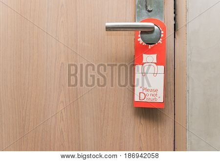 Do not disturb sign on door knob in hotel