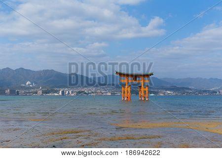 Itsukushima Shrine in Japan and sunshine