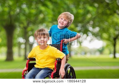 Digital composite of Portrait of boy pushing brother in wheel chair