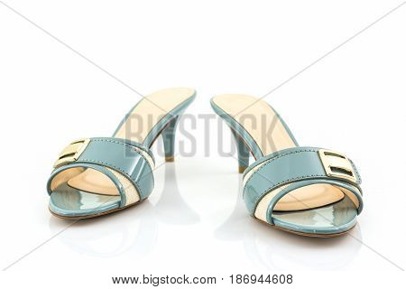 Close-up of female high heeled shoes on white background.