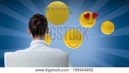 Digital composite of Digital composite image of businesswoman looking at emojis
