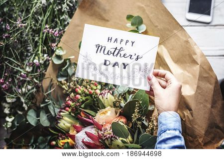 Florist Making Fresh Flowers Bouquet Arrangement with Happy Mother Day Card