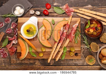 antipasti with melon,olive and meats