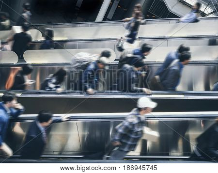 Blurred people on escalator Train Station Travel Urban city lifestyle