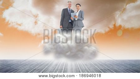 Digital composite of Digital composite image of business people using tablet computer on cloud in sky