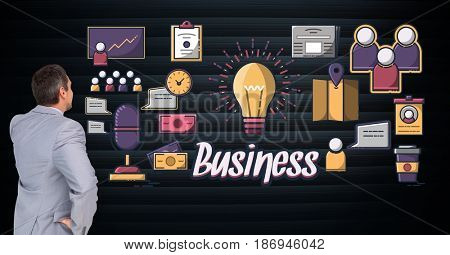 Digital composite of Digital composite image of businessman looking at electric bulb amidst various icons