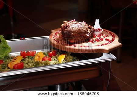 Delicious piece of grilled meat on wooden board