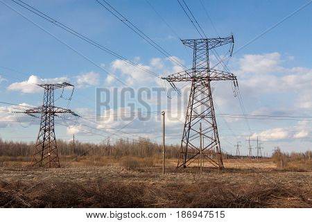 High-voltage Electric Main Against The Dark Blue Sky