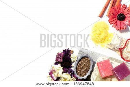 Beauty spa accessories flat lay with copy space. Soap bath salt washcloth flower petals and aroma incense. Top view.