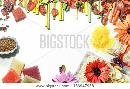 Beauty salon accessories flat lay design background. Soap bath salt washcloth flower petals and aroma incense. Top view.