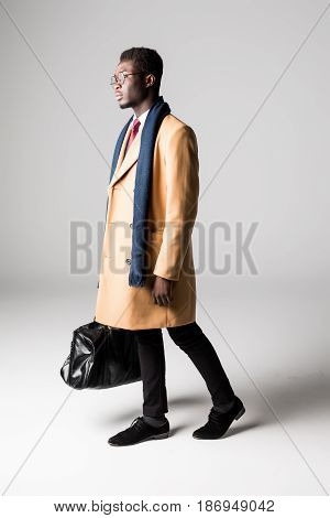 Black Businessman With Bag In Coat On White Background